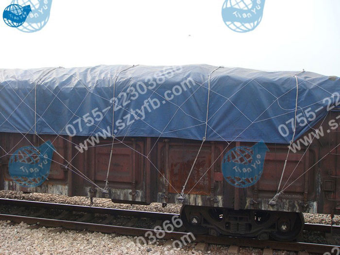 Blue tarpaulin tensile train